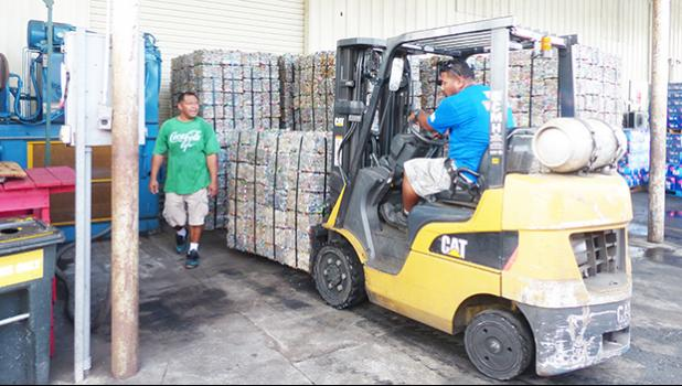 GHC Reid employees working with cans for recyling