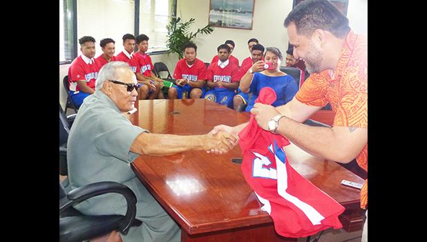 American Samoa Baseball Association president, Marcus Langkilde presented Gov. Lolo Matalasi Moliga with team jersey.