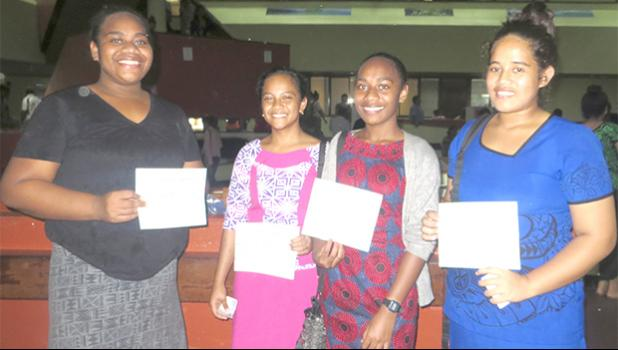 It was all smiles for these girls who received their first paycheck yesterday, for work under the Summer Youth Employment Program, administered by the Department of Human Resources. [photo: Sabrina Sinapati]