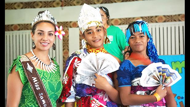 GLOW girls wearing their recycled outfits with 2018 Miss Samoa