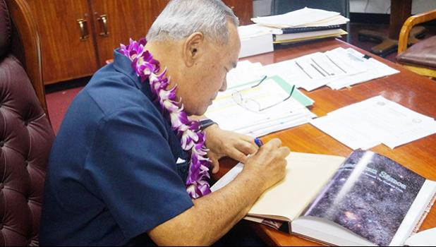Governor signs new edition of Centennial Book