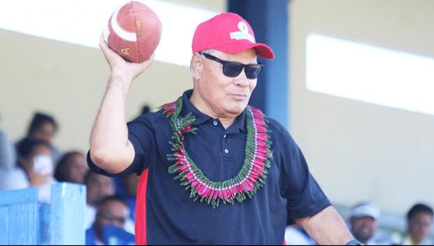 Gov. Lolo Matalasi Moliga passing football to open 2018 ASHSAA season