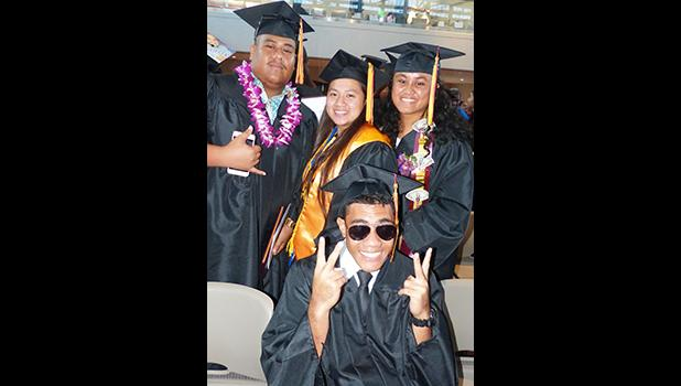 Posing for a Samoa News photo after the graduation ceremony, are some of the graduates at the American Samoa Community College's Spring 2018 graduation ceremony last Friday at the ASCC Multi Purpose Center Auditorium. [photo: Leua Aiono Frost]