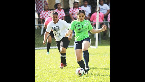A Green Bay player controls the ball against Ilaoa & To'omata