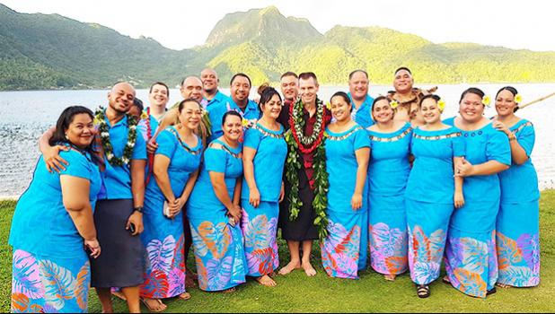 Local employees of Hawaiian Airlines, with HAL president and chief executive officer Peter R. Ingram (front row, center), posing for a group photo