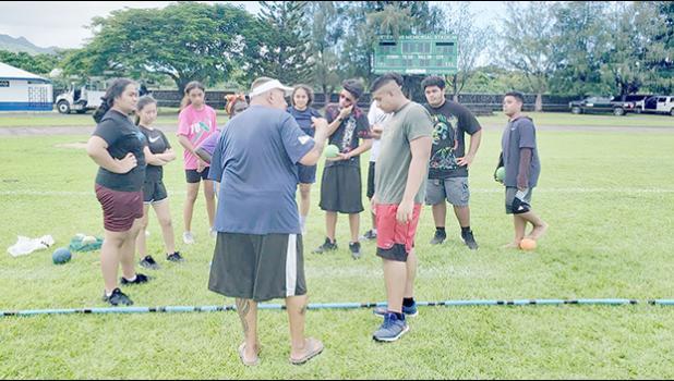 Coach CJ Sagapolutele Floor instructing Pacific Horizons School students