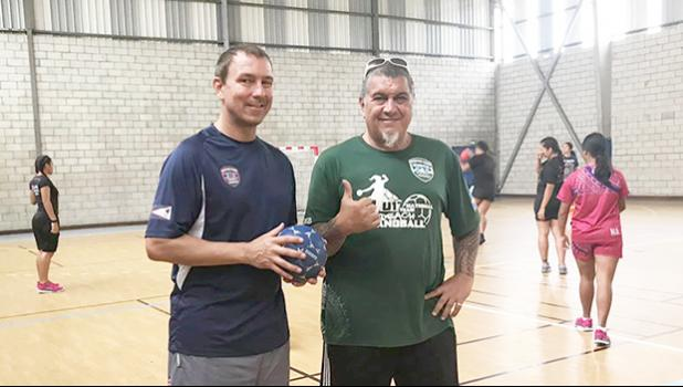 American Samoa Handball Association (ASHA) president and head coach Carl Floor Sr., and ASBA coach Michael Marsik with American Samoa's U20 Women's Handball Team practicing in the background