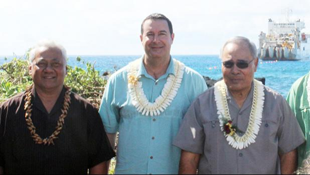 [l-r] ASTCA board chairman Sen. Fai'ivae Iuli Godinet; Hawaiki chief executive officer  Remi Galasso, and Gov. Lolo Matalasi Moliga, on the rocky-shoreline of Fogagogo last Saturday, while the vessel, Responder, anchors off on the ocean, laying the Hawaiki undersea fiber optic cable. [photo: Fili Sagapolutele]
