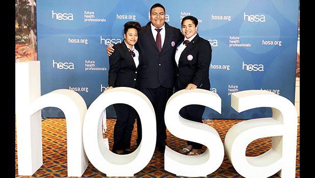 (l-r) students Chole Tuaua and Darius Shimasaki-Vaofanua and ASCC HOSA Coordinator Monica Afalava.