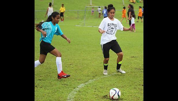 A Tafuna Jets player (left) and Ilaoa & To'omata opponent in action