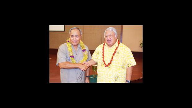 Gov. Lolo Matalasi Moliga and Tuilaepa Aiono Sailele Malielegaoi in a Samoa Observer file photo.