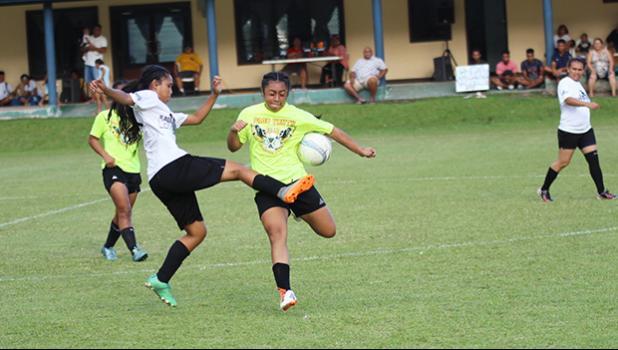 Ama Faleao (left) of Ilaoa & To'omata in action against Saono Enesi of Pago Youth