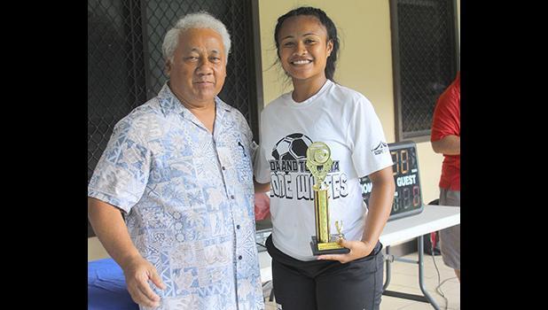 Rosie Faleao of Ilaoa & To'omata receives her women's FFAS 2018 National League championship game MVP trophy from FFAS President, Sen. Faiivae Iuli Alex Godinet