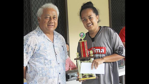 Salevu Filiva'a of Taputimu Youth receives her women's 2018 FFAS National League MVP award from FFAS President, Sen. Faiivae Iuli Alex Godinet
