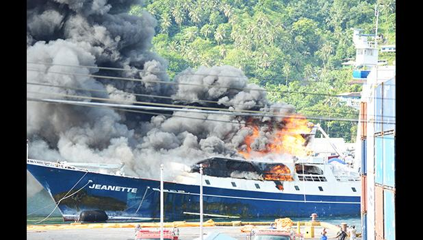 Fishing vessel Jeanette on fire at the dock in Pago Pago harbor