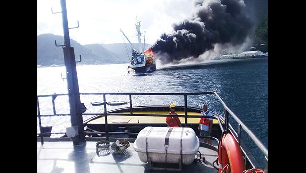 The crew of the tug Iseula tows to the 228-foot commercial fishing vessel Jeanette from the port of Pago Pago