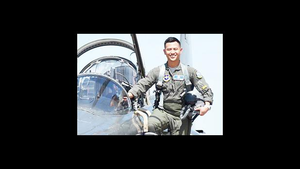 2nd LT Hanyoun Ao Jeong stepping into the cockpit of a jet airplane