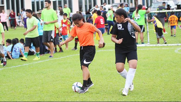 A Black Roses' player dribbles against a Tafuna Jets' opponen