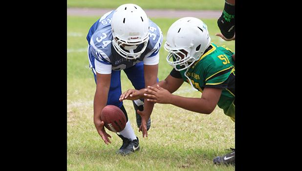 JPS Sharks punter trying to gain possession of a bad snap