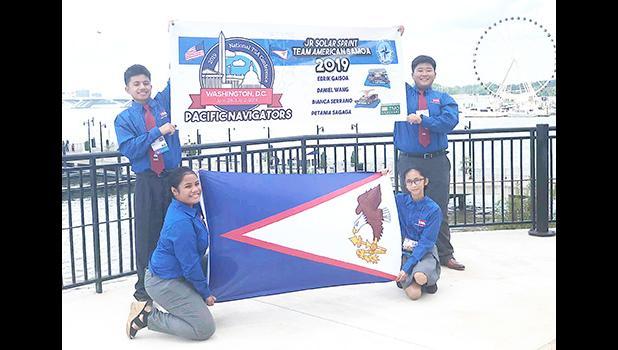 Edrik Scanlan Gaisoa, Daniel Hyuk Wang, Bianca Alenna Serrano and Petania Fou Sagaga with American Samoa flag.