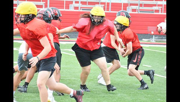 Bluffton junior Julia Mackenzie moves towards her block