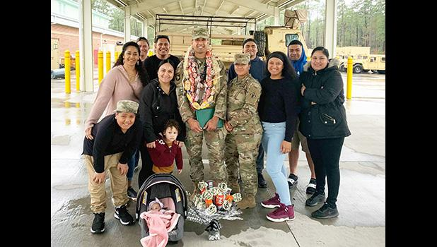 SSG Auelua with family after his promotion ceremony