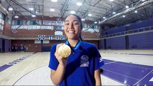 Heritage High School Timberwolves, junior Katie Peneueta with her gold medal.