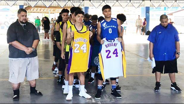 ASHSAA basketball players honoring Kobe Bryant