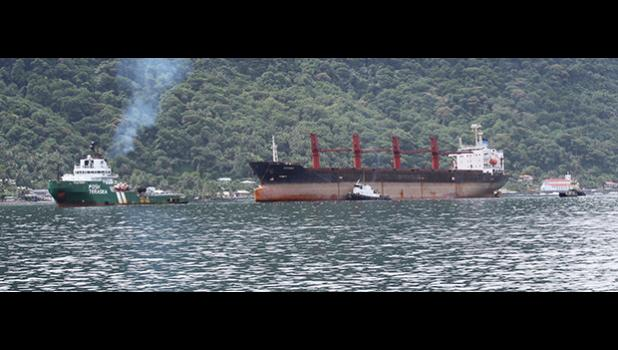 The North Korean cargo ship, Wise Honest, (middle) inside Pago Pago Harbor around 12noon last Saturday, towed in by towing vessel Posh Terasea (front).