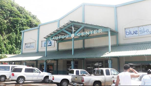 Laufou Shopping Center entrance and parking lot.