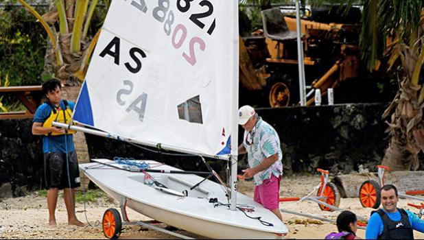 Leo Young and Jim McGuire securing Leo's Laser sailboat