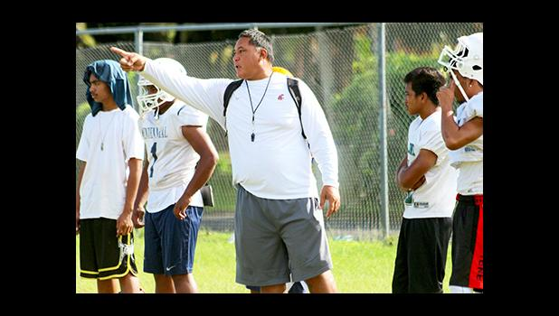 Leone Lions Head Coach, Okland Salave'a directing their strategic passing game during practice, at their school field this summer – in preparation for their game against the Vikes this Saturday. [photo: TG]