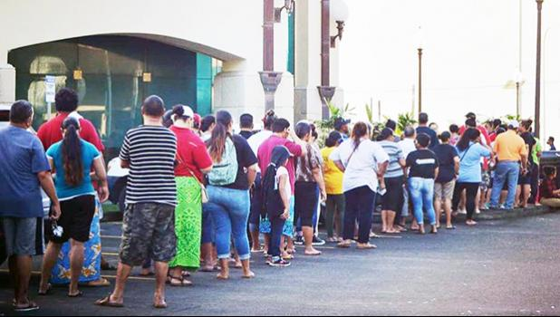 People standing in line to cash stimulus checks