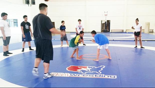 Two of the youngest participants who showed up yesterday for the free wrestling clinics being held at the DYWA Pago Pago Youth Center and taught by visiting coach Alex Ramirez. [photo: Blue Chen-Fruean]