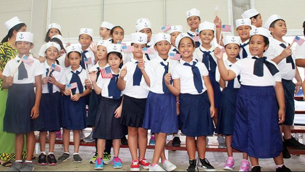 Manumalo Academy students dressesd up in sailor suits