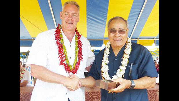 Interior Secretary Fofoga-o-Samoa Ryan Zinke presents Governor Lolo Matalasi Moliga with a special medal