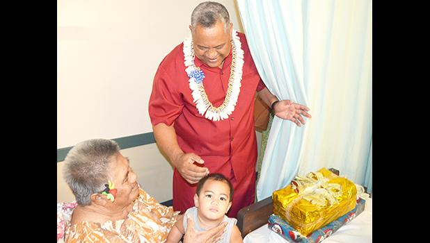 Lt. Governor Lemanu Peleti Mauga after he presented a gift to a woman and her granddaughter, during the Governor's annual visit at the Pediatric Ward at LBJ Hospital yesterday morning. [photo by AF