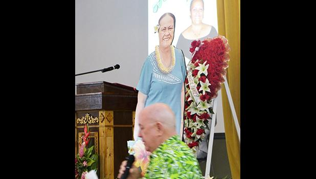 Territorial Bank of American Samoa (TBAS) president and chief executive officer David Muhler with photos of Makerita T. Polu in the background