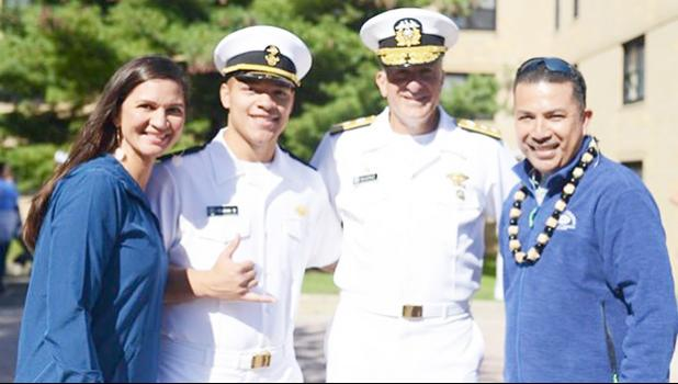 Manaia is pictured with his parents, Manaia and Laurie, and Rear Admiral Buono