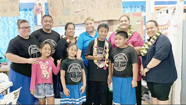 The deaf/ hard of hearing students at Manulele Tausala Elementary, pictured with instructors/ deaf educators — Dana Love-Ili and Hofeni Fitiao — and parents.