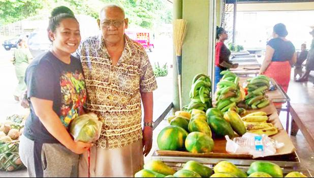 Ti'a Ofisa of Faga'itua with his granddaughter looking through the local produce sold at the Market Place in Fagatogo yesterday afternoon. Under the Reimbursement of Transportation Cost Payment Program (RTCP) commercial farmers in American Samoa are eligible to recoup up to 25% of their transportation costs for farm purchases made in fiscal year 2017. See story for full details.  [photo: Sabrina Amosa]