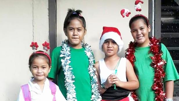 Matafao Elementary School students in their Christmas finery
