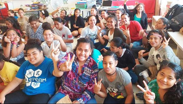 Some Level 7-8 students of Matafao Elementary School smile and wave to the camera