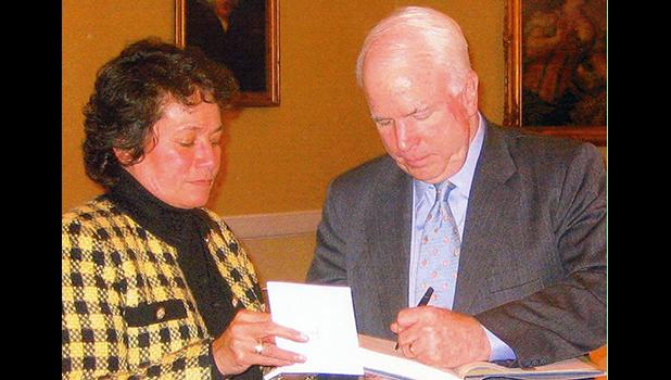 Aumua Amata with Senator John McCain.