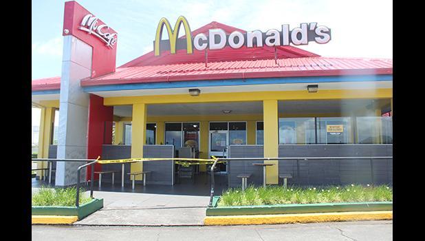 McDonald's with yellow tape around front door.