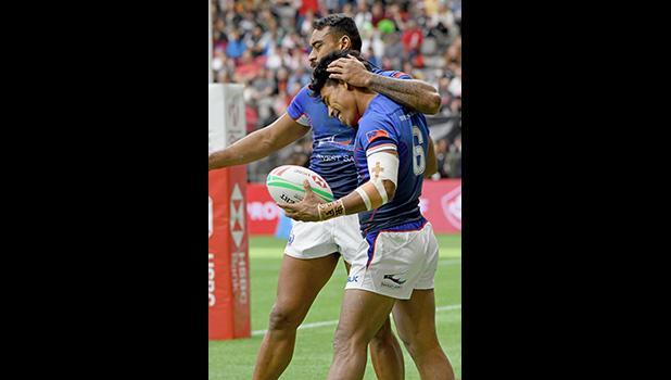 Tila Mealoi is hugged by David Afamasaga