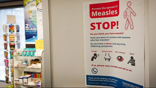Poster warns against the spread of measles.