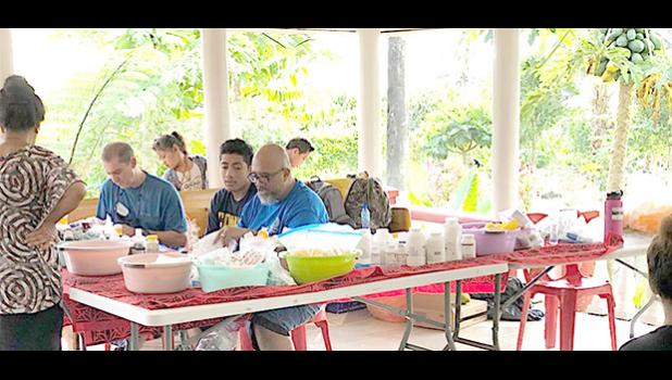 One of the doctors and local volunteer, Duffy Hudson, during one of the clinics in independent Samoa