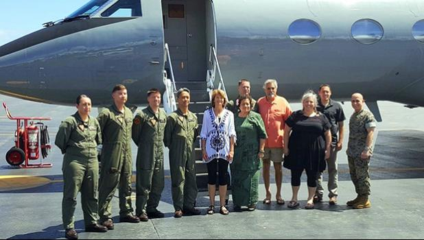 Aumua Amata with Chairman Lisa Murkowski of Alaska, and the military flight crew