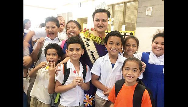 Reigning Miss American Samoa, Magalita Johnson with students.